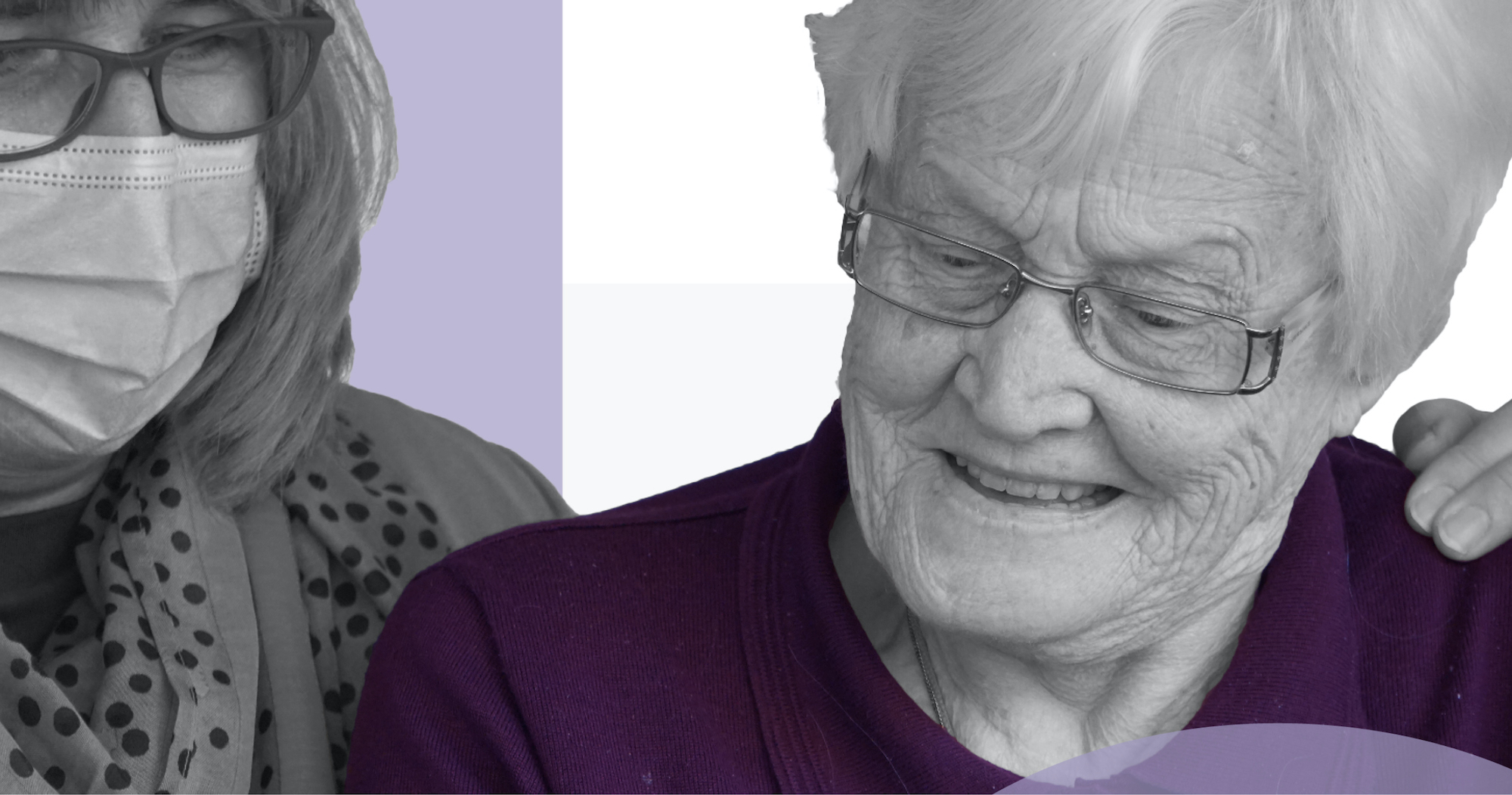 An older woman and a woman carer wearing a mask with shaded purple decoration