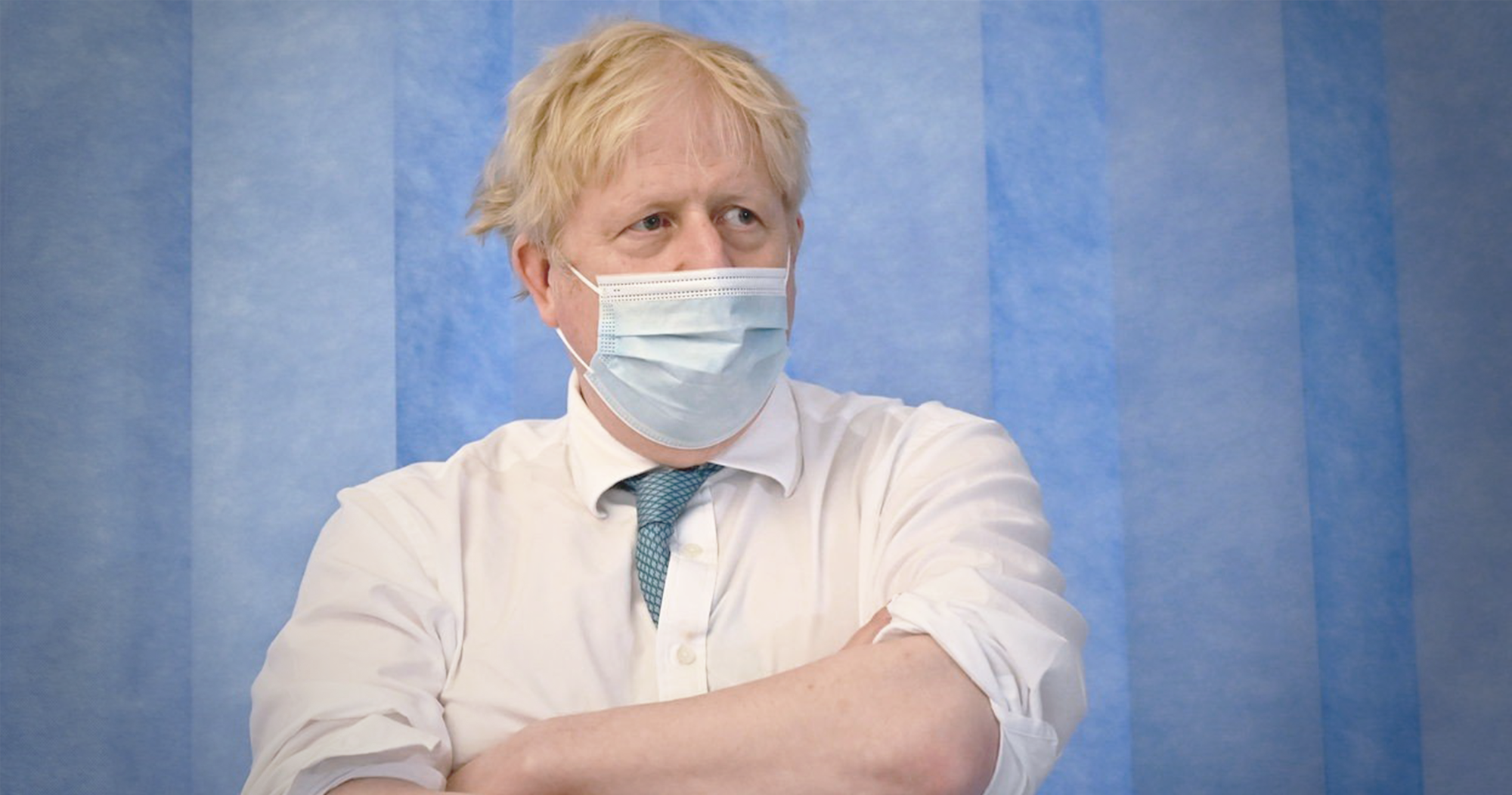 UK PM Boris Johnson wearing a face mask PPE in an NHS hospital